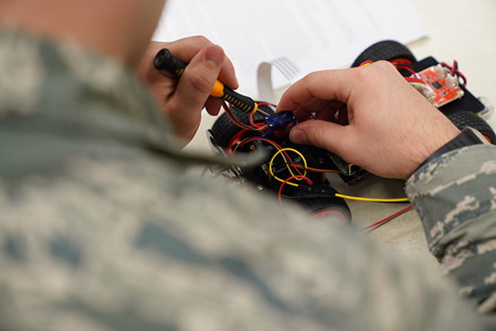 airmen working with wires and learning